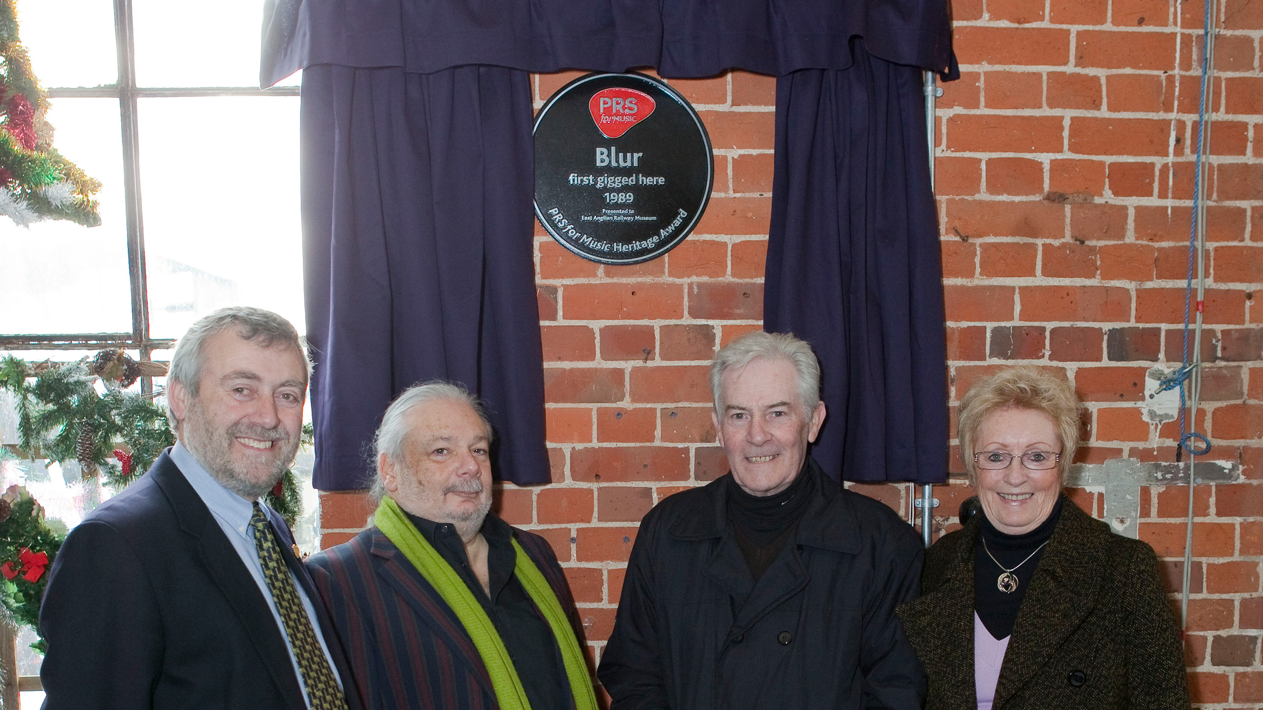 Staff from Good Sheds at East Anglian Railway Museum with their Heritage Award plaque