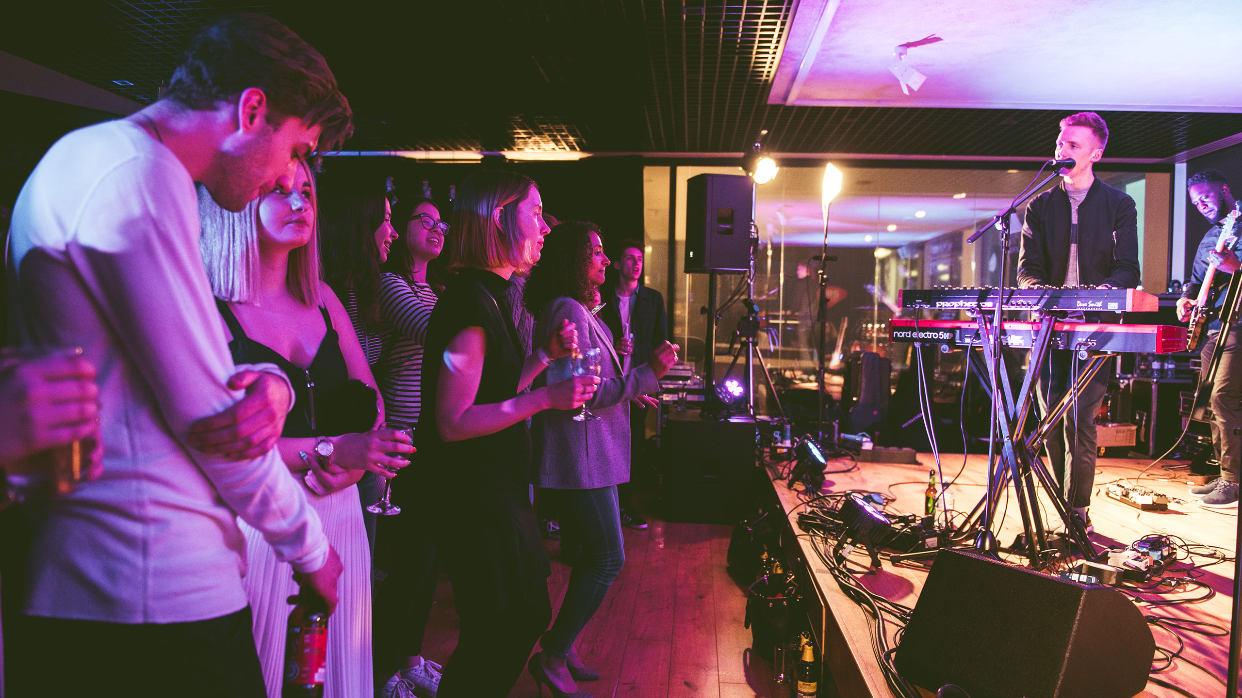 The audience watches Honne playing keyboards on stage at PRS Presents