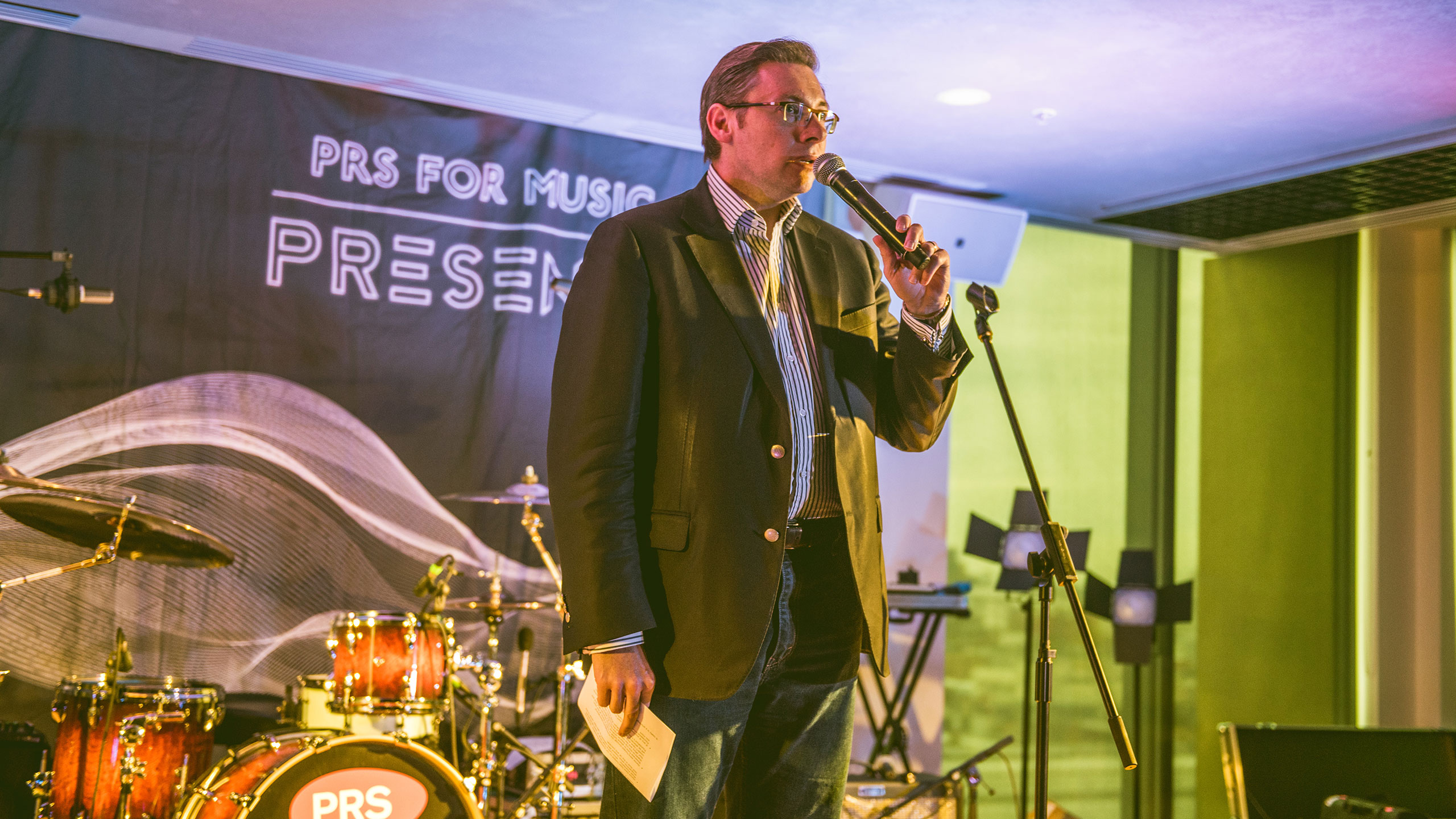 Paul Clements introduces the performers at a PRS Presents gig