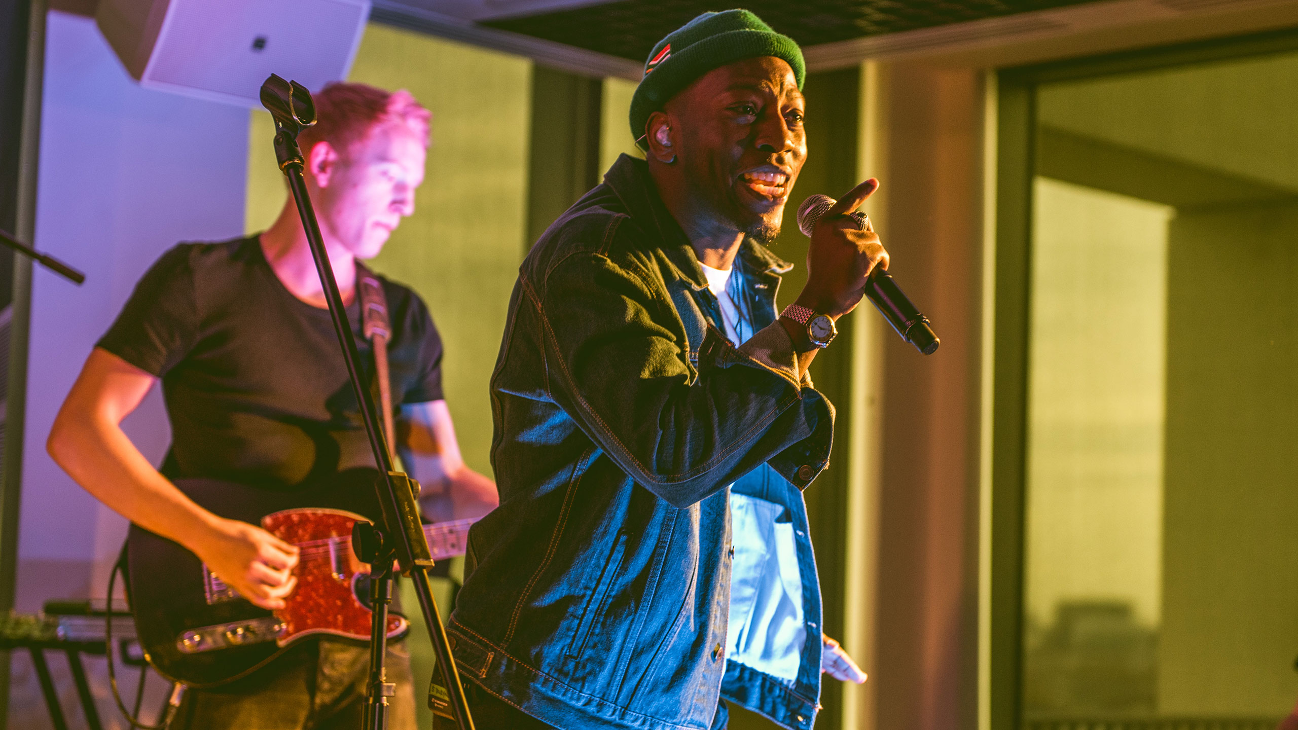Tiggs Da Author performs at PRS Presents with a man playing guitar behind him