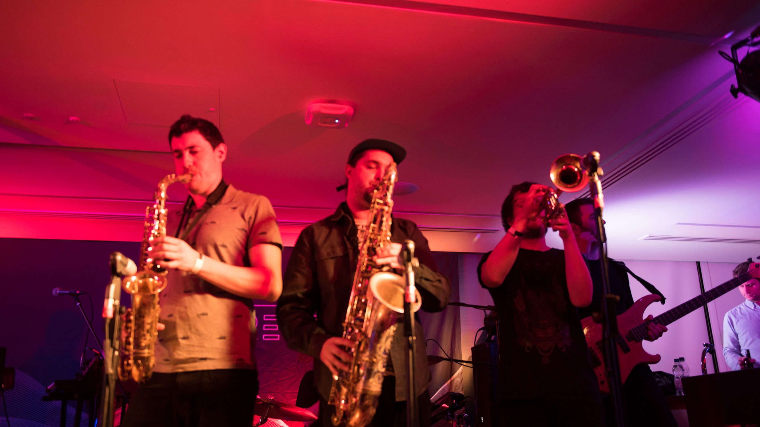Two saxophonists and a trumpeter from Dr Meaker perform live at PRS for Music Presents