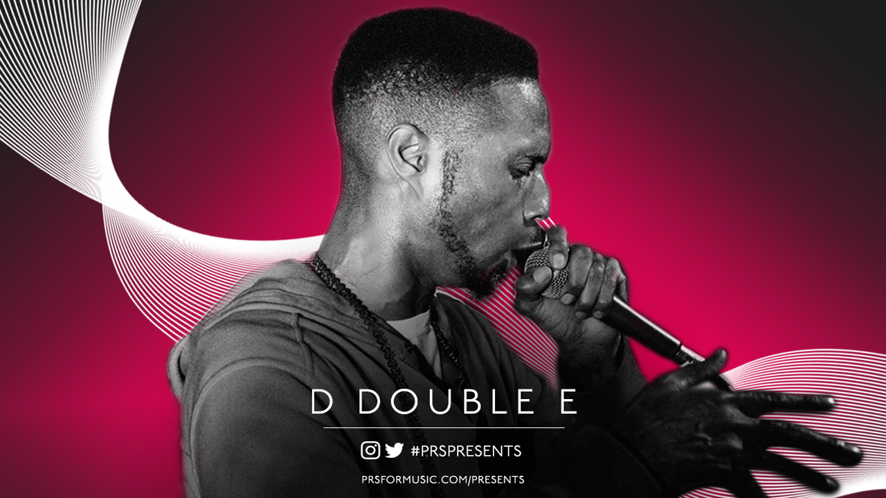 D Double E rapping into a microphone