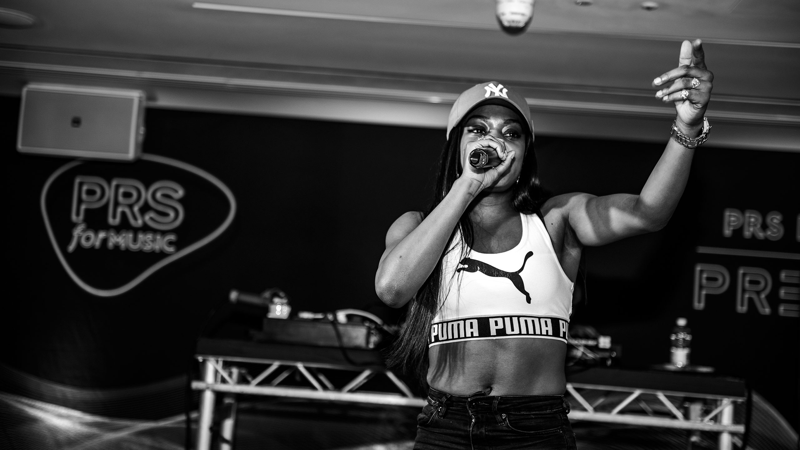 Lady Leshurr performs at PRS for Music Presents wearing a Puma top and cap