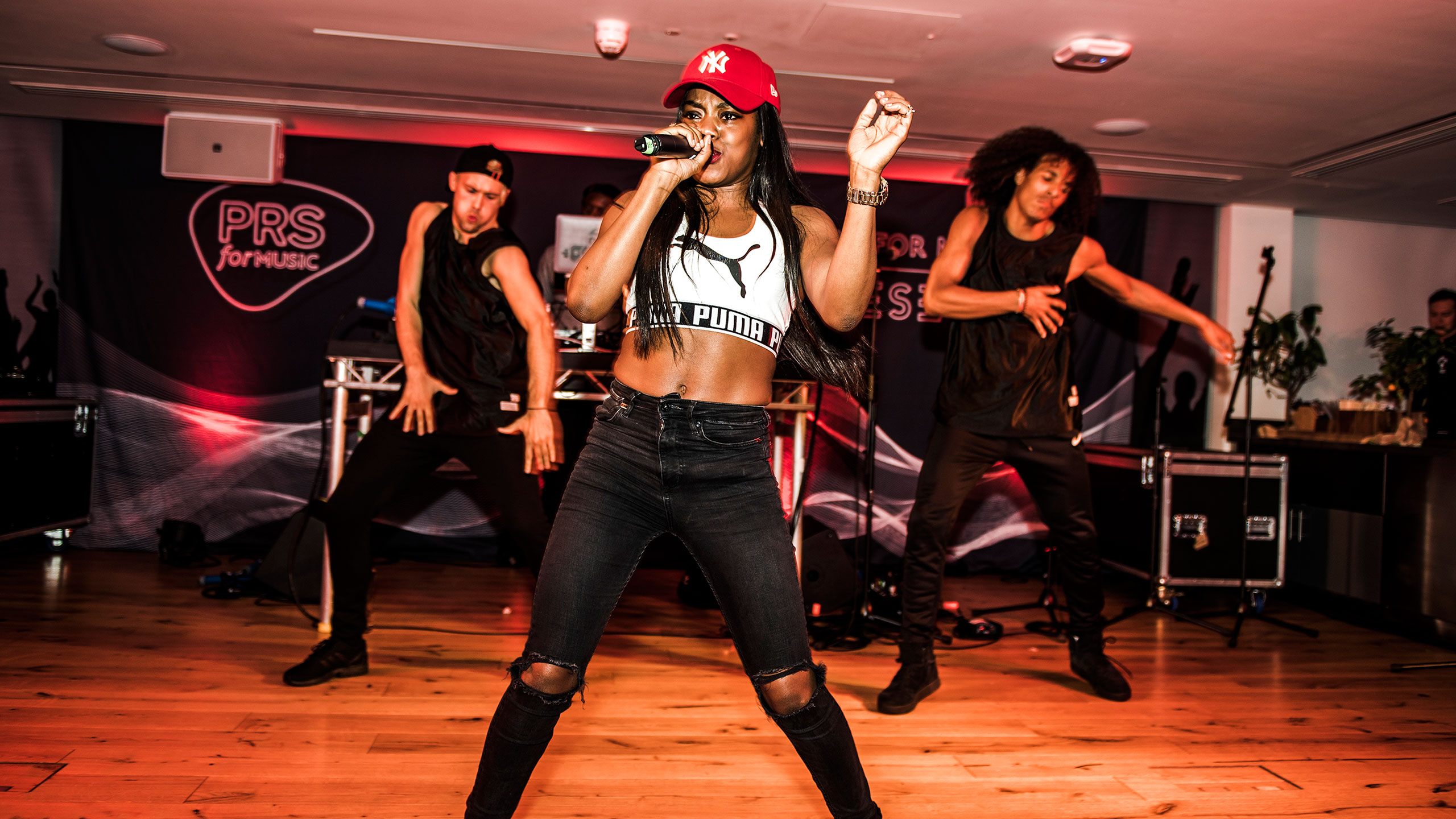 Lady Leshurr performing with two backing dancers at PRS for Music Presents