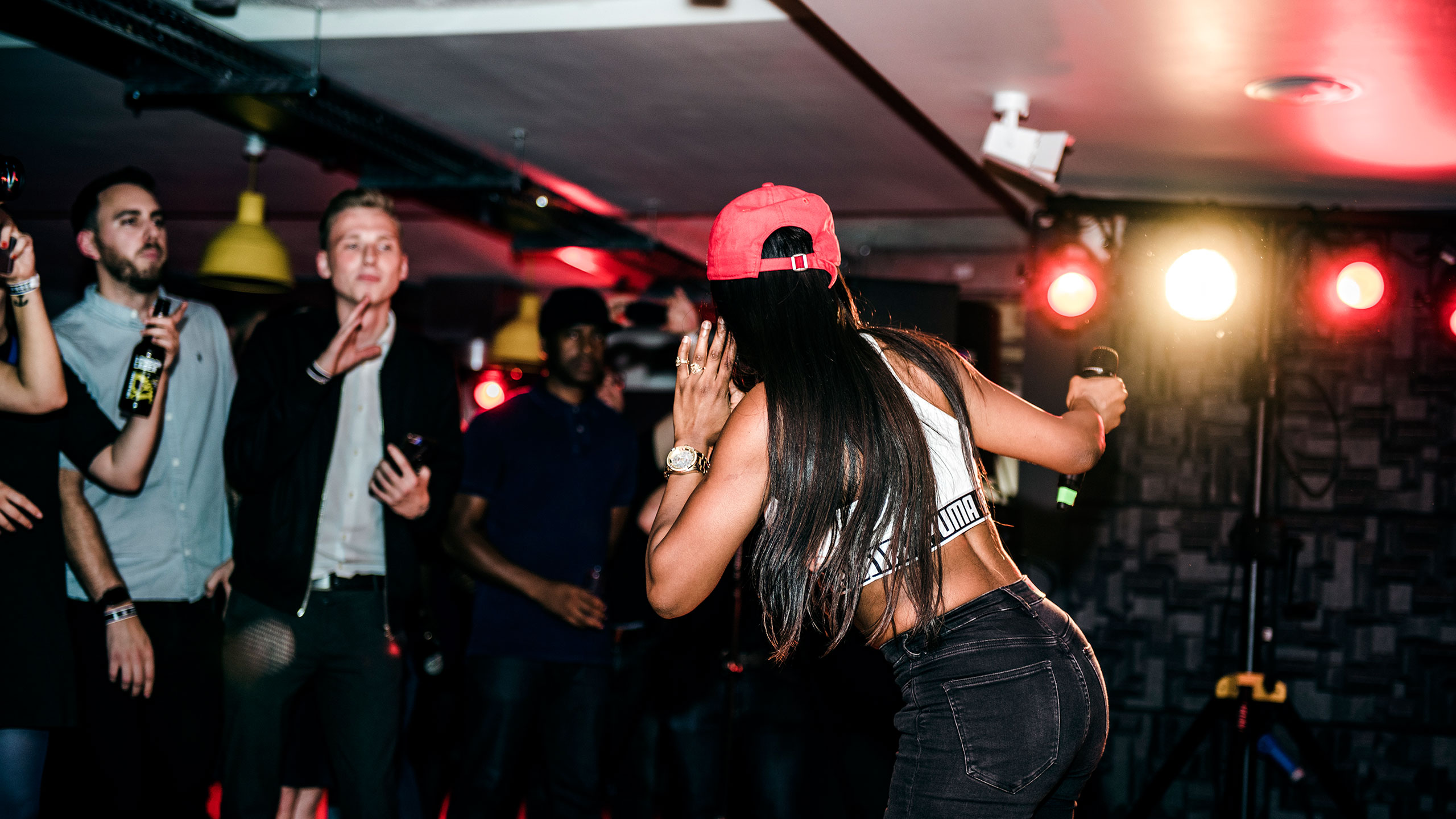 Lady Leshurr pulling her ear to the crowd at PRS for Music Presents