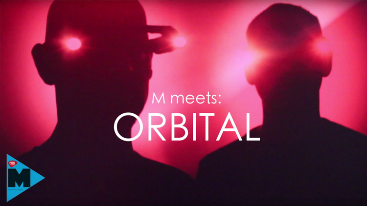Orbital wearing headsets with pink lights on